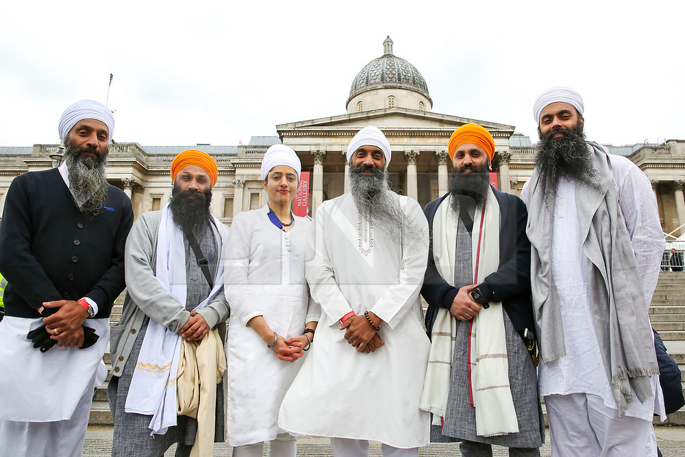 © Licensed to London News Pictures. 27/04/2019. London, UK. Sikh men and a woman poses during the Vaisakhi Festival in Trafalgar Square hosted by the Mayor of London. <br /> The Vaisakhi Festival is a religious festival that marks the Sikh New Year. This year's celebrations took place on 14 April which commemorates the beginning of Sikhism as a collective faith and London's celebrations are an opportunity for people from all communities, faiths and backgrounds to experience a festival that is celebrated by Sikhs who live in the capital and over 20 million people across the world. Photo credit: Dinendra Haria/LNP