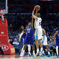 31 December 2017: Charlotte Hornets guard Nicolas Batum (5) takes a jump shot over LA Clippers guard Lou Williams (23) during the LA Clippers 106-98 victory over the Charlotte Hornets, at the Staples Center, Los Angeles, California, USA.