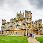 Downton Abbey's Highclere Castle. Highclere Castle, in Hampshire, is the home of the Earl and Countess of Carnarvon and is used in the filming of the British TV series Downton Abbey. The castle is open to visitors for parts of the year.