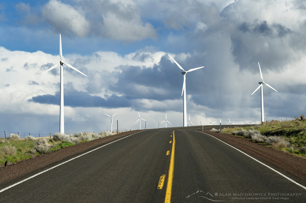 Wind Turbines along two lane highway on the Columbia Plateau, Oregon