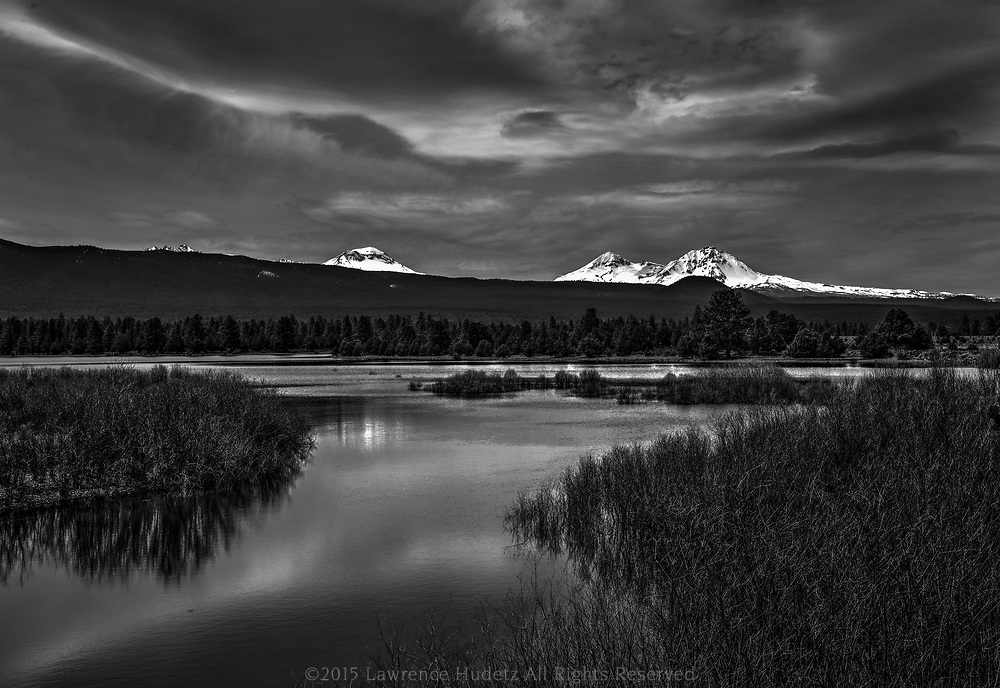 Dramatic View of the Three Sisters mountains at the Tumalo Reservoir Water Supply for Bend OR