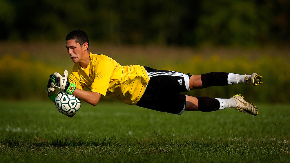 Red Bank Catholic goalie Nick Schwiezer dives to make the save during the first half of the game against Holmdel held at Dorbrook Park in Colts Neck on September 14.