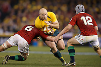 MELBOURNE, 29 JUNE - Stephen MOORE of the Wallabies is tackled by Geoff PARLING of the Lions during the Second Test match between the Australian Wallabies and the British & Irish Lions at Etihad Stadium on 29 June 2013 in Melbourne, Australia. (Photo Sydney Low / asteriskimages.com)