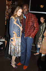 Fashion designer OZWALD BOATENG and his wife GYUNEL at the opening party for the new BECCA cosmetics store at 91a Pelham Street, London SW7 on 19th May 2005.<br />