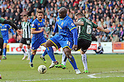 Bayo Akinfenwa forward for AFC Wimbledon (10) during the Sky Bet League 2 match between Plymouth Argyle and AFC Wimbledon at Home Park, Plymouth, England on 9 April 2016. Photo by Stuart Butcher.