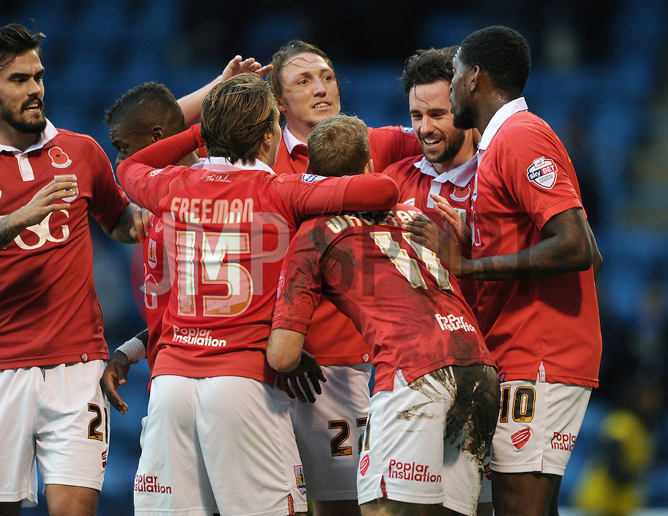 Bristol City's Greg Cunningham celebrates with his team mates after scoring. - Photo mandatory by-line: Dougie Allward/JMP - Mobile: 07966 386802 - 08/11/2014 - SPORT - Football - Gillingham - Priestfield Stadium - Gillingham v Bristol City - FA Cup - Round One