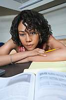 Female student working in lecture theatre