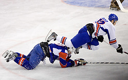 Robert Dowd  of Great Britain (12) vs PANCE Ziga of Slovenia (L) at IIHF Ice-hockey World Championships Division I Group B match between National teams of Slovenia and Great Britain, on April 20, 2010, in Tivoli hall, Ljubljana, Slovenia.  (Photo by Vid Ponikvar / Sportida)
