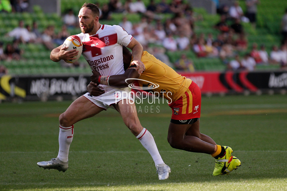 Josh Hodgson of England gets tackled during the Rugby League World Cup Quarter-Final match between England and  Papua New Guinea at Melbourne Rectangular Stadium, Melbourne, Australia on 19 November 2017. Photo by Mark  Witte.
