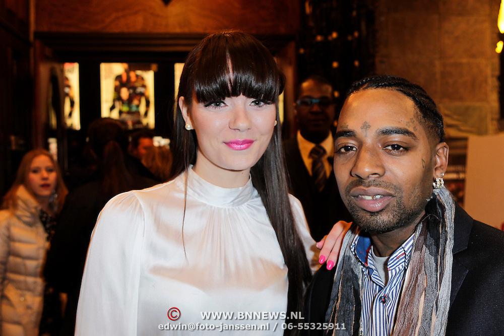 NLD/Amsterdam/20120123 - Premiere Black Out, rapper Kempi en fotomodel Syrou Scheer