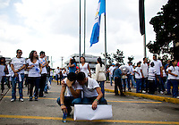 A young man is comforted as he cries at a anti president rally during a video presentation of violence in the country as citizens take to the streets in a day of protest in connection with Guatemala's President Alvaro Colom in Guatemala City May 17, 2009. . Thousands of protesters took to the streets of the capital  Sunday in two separated rival marches, one in support of the President and one denouncing President Alvaro Colom who was accused this week of murder, money laundering and having ties with narco-traffickers.(Darren Hauck)