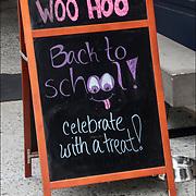 "Blackboard humorous outdoor sign. ""WOO HOO Back to School celebrate with a treat !"""