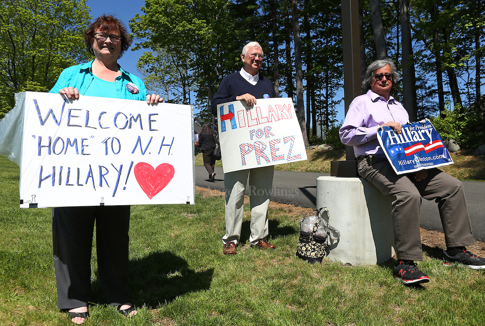 (Hampton, NH - 5/22/15) Deb Crapo of Rye, N.H., left, David Ewingof Portsmouth, N.H., and Gaetan Digangi of Merrimack, N.H., hold signs supporting presidential candidate Hillary Clinton outside Smuttynose Brewery, Friday, May 22, 2015. Staff photo by Angela Rowlings.