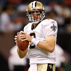 August 21, 2010; New Orleans, LA, USA; New Orleans Saints quarterback Drew Brees (9) during warm ups prior to kickoff of a preseason game against the Houston Texans at the Louisiana Superdome. Mandatory Credit: Derick E. Hingle