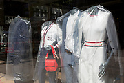 As the UK's Coronavirus death toll during the government's social distancing lockdown, rose by 384 to 33,998, and the R rate of infection is reported to be between 0.7 and 1.0, clothing mannequins in the window of a closed branch of Ted Baker, are covered in polythene plastic, in a deserted City of London, the capital's financial district, on 15th May 2020, in London, England.