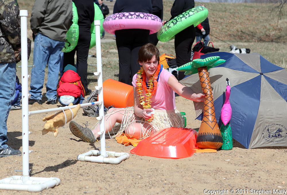Dawn Pulford, of Burlington, sets up her beach scene at the Polar Plunge event at Pleasant Creek State Recreation Area in Palo on Saturday March 26, 2011. 28 team participated in the event which was sponsored by local law enforcement agencies and raised money for Special Olympics Iowa.
