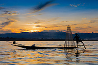 INLE LAKE, MYANMAR - DECEMBER 09, 2016 : Fisherman fishing at sunset on the Inle Lake Shan state in Myanmar (Burma)
