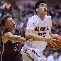 Gallup Bengal Colton Lowley (32) spins past Belen Eagles Justin Evans (4) Saturday at Gallup High School.