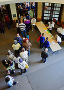 Attendees of the Scripps College of Communication Spelling Bee line up outside the Walter Hall Rotunda for a free pizza lunch provided by the Scripps College of Communication Saturday, March 16, 2013.