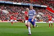 Pavel Pogrebnyak of Reading goes after a long ball during the Sky Bet Championship match at The Valley, London<br /> Picture by Andrew Tobin/Focus Images Ltd +44 7710 761829<br /> 05/04/2014