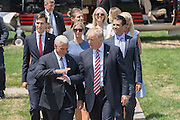 GOP Presidential nominee Donald Trump walks with Vice Presidential nominee Indiana Governor Mike Pence and his children as he arrives for the Republican National Convention July 20, 2016 in Cleveland, Ohio. Trump flew into the lakeside airport by his private jet and then by helicopter for a grand arrival.