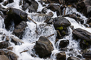 """Water tumbles down Chalice Creek, in Bugaboo Provincial Park, in the Purcell Range of the Columbia Mountains, British Columbia, Canada. Most tourists are attracted by nearby Canadian Rockies parks along fast paved highways and skip gravel logging roads, thereby leaving the spectacular """"Bugaboos"""" as a quiet retreat for hikers, climbers, and luxury CMH helicopter guests. Directions: From Brisco (about 44 kms north of Invermere on Hwy 95), follow signs to Bugaboo Provincial Park and CMH Lodge on a gravel logging road. After 47 kms, turn right on a rougher road to reach Cobalt Lake trail head and Kain Hut trail head, or continue straight along Bugaboo Forest Service Road. Before you reach the gate of luxury CMH Bugaboo Lodge, a left turn crosses Bugaboo Creek bridge: then a left reaches Bugaboo Septet Recreation Site (4 primitive campsites in a free, user-maintained campground reachable by 2WD vehicles) or straight up takes 4WD vehicles and hikers to Chalice Creek trailhead."""