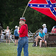 Rocco Smith, 12, of Smithsburg, Maryland, walks to join thousands of others to participate in the Pickett's Charge Commemorative March, during the Sesquicentennial Anniversary of the Battle of Gettysburg, Pennsylvania on Wednesday, July 3, 2013.  Visitors were given the opportunity to follow in the footsteps of Confederate soldiers by walking with living historians and park rangers along the path of the famously ill-fated Pickett's Charge, which brought to a close The Battle of Gettysburg when the Union Army repelled their advance. The Battle of Gettysburg lasted from July 1-3, 1863 resulting in over 50,000 soldiers killed, wounded or missing.  John Boal Photography