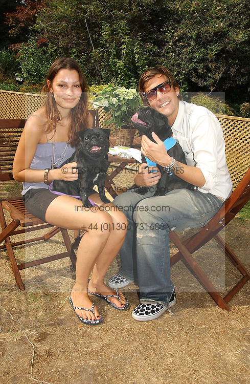 OSCAR HUMPHRIES and SARA PHILIPPIDIS with his dogs Gus and Taz at the Macmillan Cancer Support Dog Day held in the gardens of the Royal Hospital, Chelsea, London on 4th July 2006.<br /><br />NON EXCLUSIVE - WORLD RIGHTS