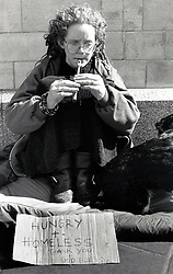 Homeless woman begging on the streets, Nottingham UK 1990s