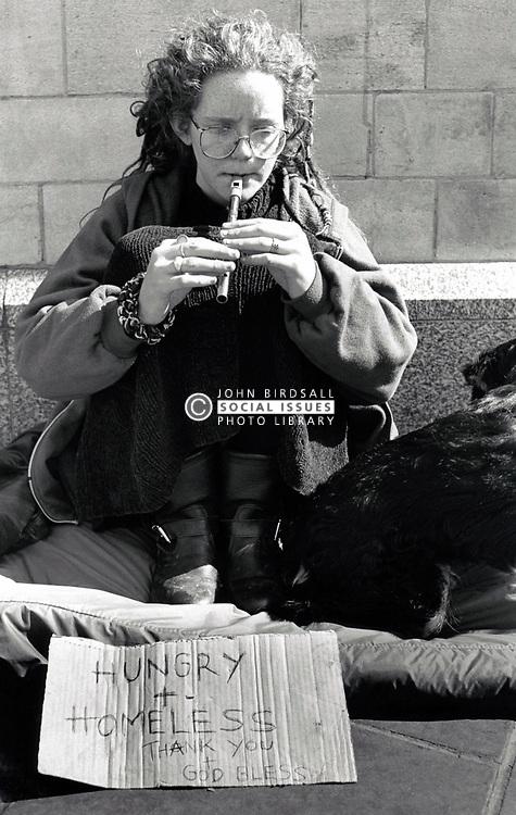 Homeless woman begging on the streets, Nottingham UK 1990s