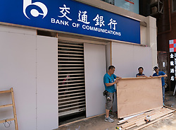 Kowloon, Hong Kong, China,. 7 October, 2019. After a night of violent confrontations between police and pro-democracy protestors in MongKok and YauMaTei in Kowloon, many MTR railway stations and what are thought to be pro-Beijing business franchises were vandalised. Protective hoardings fitted to Chines Bank of Communications.