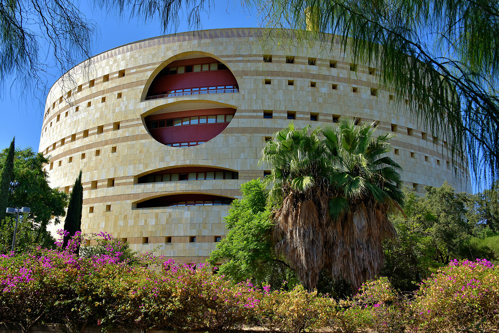 Torre Triana on Cartuja Island in Seville, Spain<br /> Since 1993, the biggest administrative offices for the Board of Andalusia, the governing body of the Autonomous Community, are located in Torre Triana on Isla de La Cartuja. The circular, Post-Modern design by Francisco Javier S&aacute;enz de Oiza was inspired by the 2nd century Castle of Sant&rsquo;Angelo along the Tiber River in Rome.