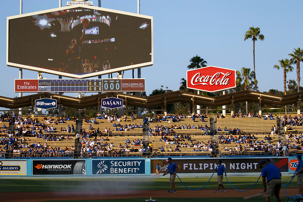 Footage of Lakers draft pick Lonzo Ball is played on a screen before throwing out the first pitch at Dodger Stadium on Friday, June 23, 2017 in El Segundo, California. The Lakers selected Lonzo Ball as the No. 2 overall NBA draft pick and is the son of LaVar Ball. © 2017 Patrick T. Fallon
