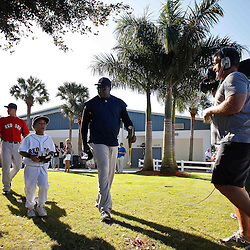 February 19, 2011; Fort Myers, FL, USA; Boston Red Sox first baseman David Ortiz (34) and son D'Angelo Ortiz walk out to spring training practice at the Player Development Complex.  Mandatory Credit: Derick E. Hingle