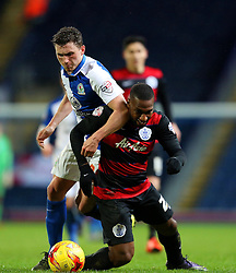 David Holiett of Queens Park Rangers is challenged by Blackburn's Cory Evans - Mandatory byline: Matt McNulty/JMP - 12/01/2016 - FOOTBALL - Ewood Park - Blackburn, England - Blackburn Rovers v QPR - SkyBet Championship