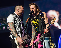 © Licensed to London News Pictures. 24/04/2014. London, UK.   McBusted performing live at The O2 Arena.  In this picture - Matt Willis (left), Dougie Poynter (right).   *** LICENSE CONDITIONS USAGE ALLOWED ONLY UNTIL 14 MAY 2014, NO USAGE BEYOND THAT DATE***.  McBusted are an English pop-rock group composed of members of the bands Busted & McFly - James Bourne, Tony Fletcher, Danny Jones, Harry Judd, Dougie Poynter, and Matt Willis.  The only member of the original groups not participating in the new lineup is former Busted singer CharlieSimpson. Photo credit : Richard Isaac/LNP