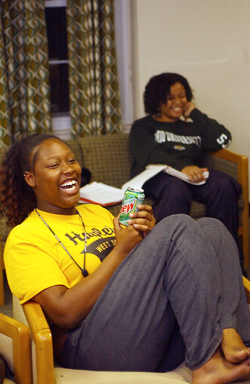 16646Students watching and discussing Presidential Debate: Photos by Colby Ware..9/30/04--Ashley Hudson (foreground) and Cherice Byrd share a little humor with fellow students during a post Presidential Debate discussion in Atkinson House.