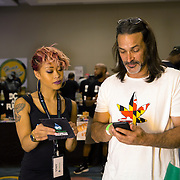 Washington, DC - AUG20: Teena Pham, 24, working for DC Hydproponics during the Bud Summit, explains their products at the B.U.D. Summit, the Business, Understanding, & Development Summit. The BUD Summit is poised to capture and accelerate the explosion of cannabis culture, business, and investment that has occurred in Washington, D.C. since the passing of initiative 71 in 2015. Photo by Evelyn Hockstein