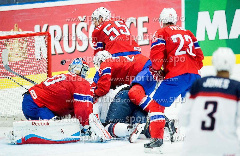 Trevor Lewis of USA under Lars Haugen of Norway, Niklas Roest of Norway, Ole-Kristian Tollefsen of Norway and Mats Trygg of Norway  during Ice Hockey match between Norway and USA at Day 2 in Group B of 2015 IIHF World Championship, on May 2, 2015 in CEZ Arena, Ostrava, Czech Republic. Photo by Vid Ponikvar / Sportida