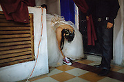 A young woman adjusts his sport shoes before to go to the dance floor during her fifteenth birthday celebration in Ciudad Nezahualcoyotl, April 2, 2011.
