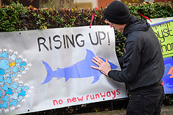 © Licensed to London News Pictures. 22/12/2016. London, UK. Campaigners put up No Heathrow 3rd Runway signs outside Ealing Magistrates Court in London, where 15 protestors are charged with Wilful Obstruction of the Highway after blocking an access road to Heathrow on November 18, 2016. Photo credit: Ben Cawthra/LNP