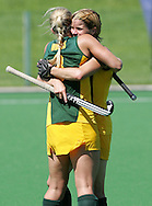 Jennifer WILSON and Kate WOODS hug at the end of the match during the BDO Women's Champions Challenge 1 match between South Africa and Spain held at the Hartleyvale Stadium in Cape Town, South Africa on the 17 October 2009 ..Photo by RG/www.sportzpics.net.+27 21 (0) 21 785 6814