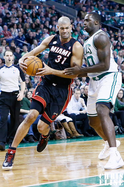 27 January 2013: Miami Heat small forward Shane Battier (31) drives past Boston Celtics power forward Brandon Bass (30) during the Boston Celtics 100-98  2OT victory over the Miami Heat at the TD Garden, Boston, Massachusetts, USA.