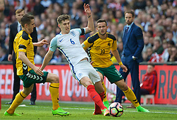 LONDON, ENGLAND - Sunday, March 26, 2017: England's John Stones in action against Lithuania's Deivydas Matulevičius during the 2018 FIFA World Cup Qualifying Group F match at Wembley Stadium. (Pic by Lexie Lin/Propaganda)