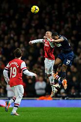 Arsenal Defender Kieran Gibbs (ENG) and Man Utd Midfielder Luis Antonio Valencia (ECU) compete in the air - Photo mandatory by-line: Rogan Thomson/JMP - 07966 386802 - 12/02/14 - SPORT - FOOTBALL - Emirates Stadium, London - Arsenal v Manchester United - Barclays Premier League.