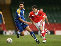 Photo: Rich Eaton.<br /> <br /> Wales v Cyprus. UEFA European Championships 2008 Qualifying. 11/10/2006. Simon Davies of Wales right