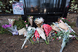 © Licensed to London News Pictures. 26/12/2016. Floral tributes and messages are left outside the Highgate home of singer GEORGE MICHAEL who died of heart failure at his Oxfordshire home aged 53. London, UK. Photo credit: Ray Tang/LNP