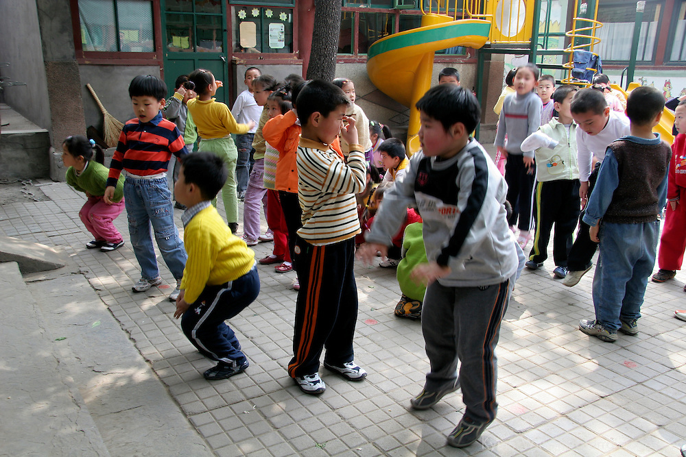 Asia, China, Beijing. Kindergarten school children having physical fitness.