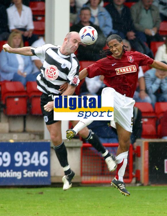 Photo: Dave Linney.<br /> Walsall v Darlington. Coca Cola League 2. Coca Cola League 2. 26/08/2006. Walsall's Chris Westwood (R) beats Barry Conlon to the ball.