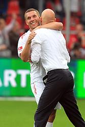 17.09.2011,  BayArena, Leverkusen, GER, 1.FBL, Bayer 04 Leverkusen vs 1. FC Koeln, im Bild.Lukas Podolski (Koeln #10) und Stale Solbakken (Trainer Koeln) herzen sich nach dem 1:4 Sieg..// during the 1.FBL, Bayer Leverkusen vs 1. FC Köln on 2011/09/17, BayArena, Leverkusen, Germany. EXPA Pictures © 2011, PhotoCredit: EXPA/ nph/  Mueller *** Local Caption ***            ****** out of GER / CRO  / BEL ******